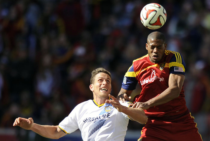 Real Salt Lake defender Chris Schuler (28) heads the ball over Los Angeles Galaxy forward Rob Friend (16) during a game at Rio Tinto Stadium on Saturday, March 22, 2014.