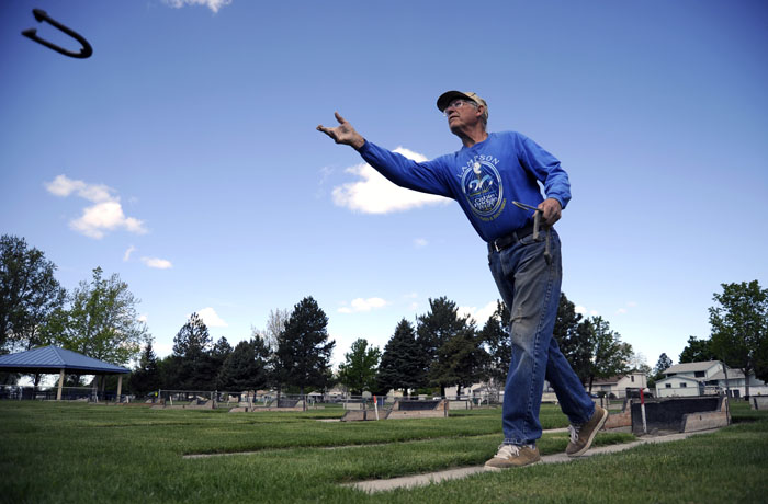 Larry Getts practices his horseshoe tossing out at Eastgate Park on Monday, April 28, 2014. Getts is a part of the Columbia Basin Horseshoe Club that has league play every Tuesday throughout the summer.