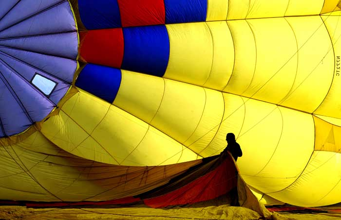 A helper stretches out part of a balloon as it is inflated during the media day launch on Thursday, May8, 2014 to prepare for the 40th Annual Walla Walla Balloon Stampede that runs this Friday through Sunday at Garrison Middle School in Walla Walla.