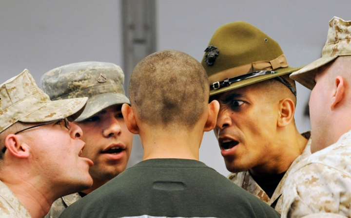 Sgt. Francisco Sanchez, PFC Kyle Dalls, Staff Sgt. Belter Jordan and Cpl. Daniel Miller are in the face of cadet Daniel during the induction of the latest recruits at Camp Outlook in Connell as part of their Juvenile Offender Basic Training Camp.