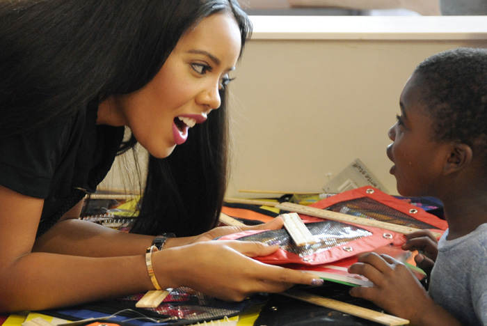 Celebrity Angela Simmons gives 5-year-old Dushawn Right school supplies as Simmons along with Target partnered up with McDonald's to provide free school supplies for underprivileged kids at the McDonald's at 428 Grand Street in Jersey City on Wednesday, Sept. 3, 2014. Other celebrities on hand included Jadakiss and MAINO. Matt Gade | The Jersey Journal