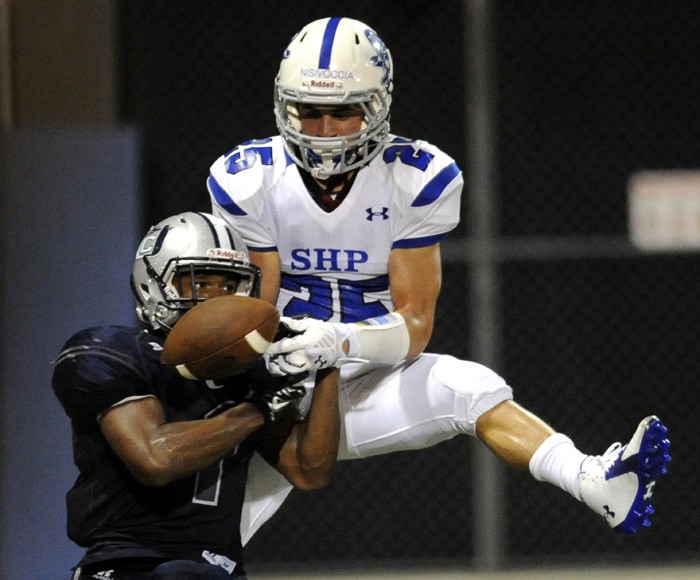 Union City's Jonathan Castellano, left, breaks up a pass intended for Seton Hall Preparatory's Vincent Nisivoccia during a game at Union City. on Friday, Sept. 5, 2014. Matt Gade | The Jersey Journal