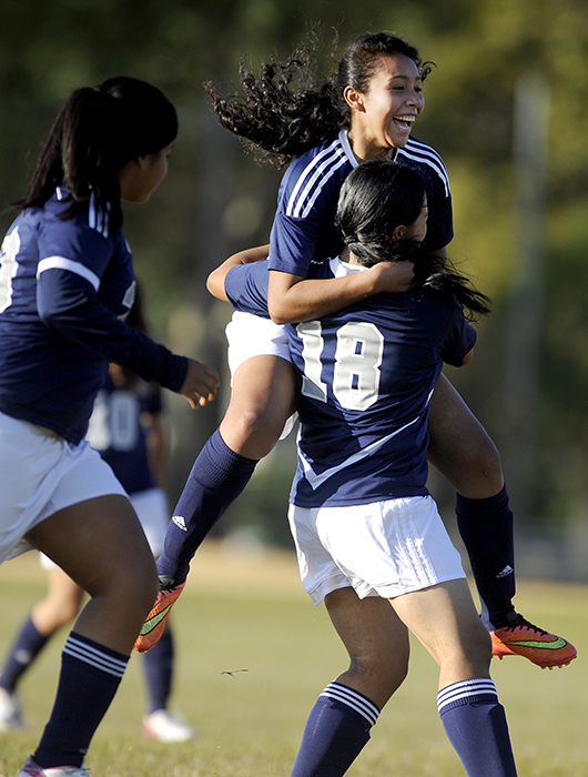 Union City's Jensy Diaz jumps into the arms of her teammate Alexis Armengolt after a goal during a game against Hudson Catholic at Lincoln Park in Jersey City on Wednesday, Sept. 17, 2014. Matt Gade | The Jersey Journal