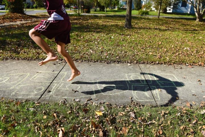 Seven-year-old Joel Hubbard plays hopscotch on Center Street in Berea.