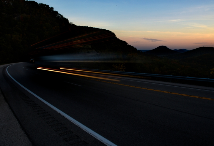 Trucks make their way through the mountains along Highway 421 early in the morning.