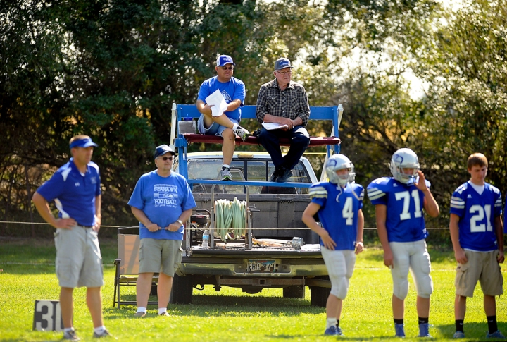 With crowded bleachers, fans made due with their own bleachers on the back of a pick-up truck during a game in Ethan on Friday, Sept. 26, 2014. Matt Gade | The Daily Republic
