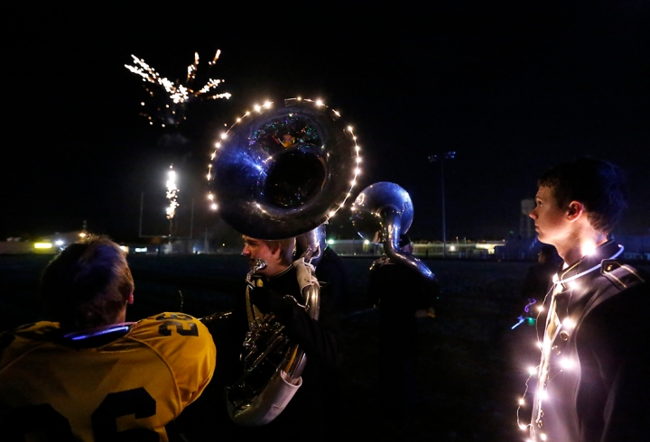 Members of the Mitchell High School band perform under darkness using a variety of glow in the dark light accessories and concluding with fireworks as part of the Lights Out performance following MHS' football game against Sioux Falls Roosevelt on Friday night at Joe Quintal Field in Mitchell. (Matt Gade/Republic)
