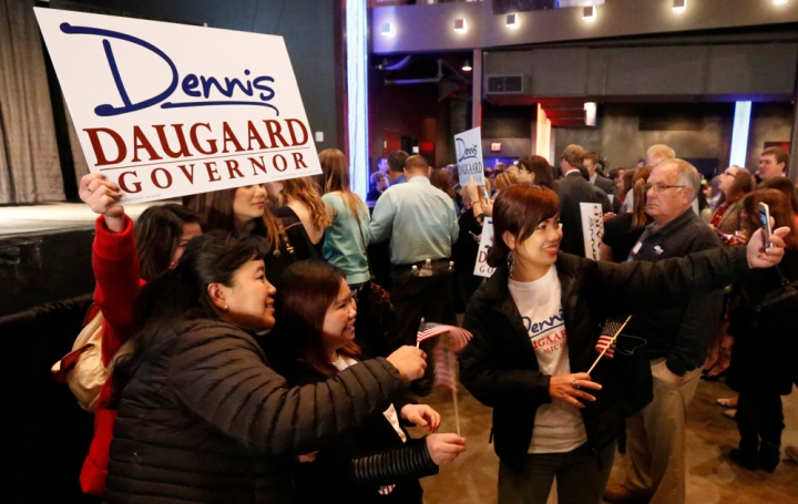 A group of women take a selfie with a Gov. Dennis Daugaard sign during the Republican Election Party on Tuesday night at The District restaurant in Sioux Falls. (Matt Gade/Republic)
