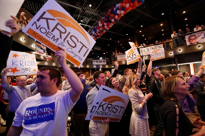 Supporters hold up Kristi Noem signs during the Republican Election Party on Tuesday night at The District restaurant in Sioux Falls. (Matt Gade/Republic)