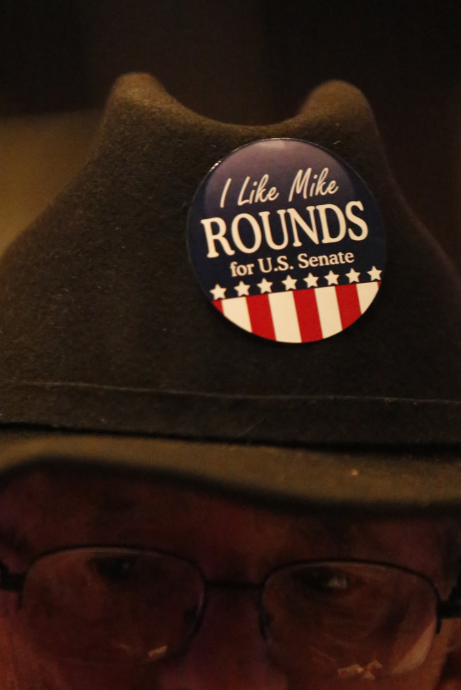 A Mike Rounds supporter shows his support with a pin on his hat during the Republican Election Party on Tuesday night at The District restaurant in Sioux Falls. (Matt Gade/Republic)