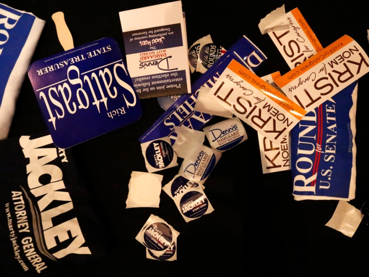 A collection of campaign materials lie on a table during the Republican Election Party on Tuesday night at The District restaurant in Sioux Falls. (Matt Gade/Republic)