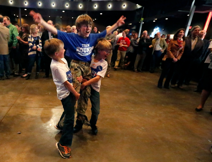 Donald Rounds is hoisted up by Zayden Rounds and Williams rounds during the Republican Election Party on Tuesday night at The District restaurant in Sioux Falls. (Matt Gade/Republic)