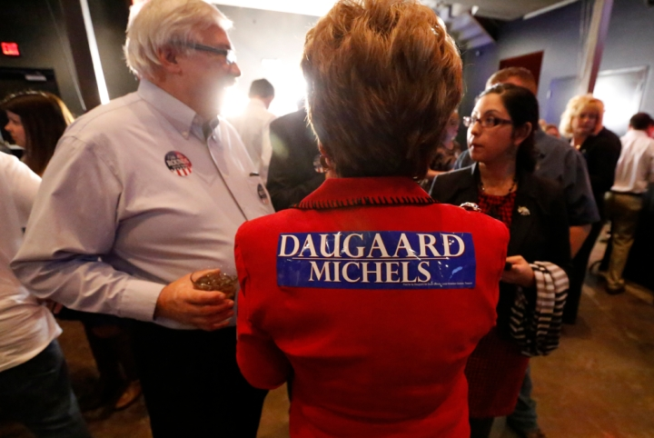 A Gov. Dennis Daugaard supporter shows her support with a bumper sticker on her back during the Republican Election Party on Tuesday night at The District restaurant in Sioux Falls. (Matt Gade/Republic)