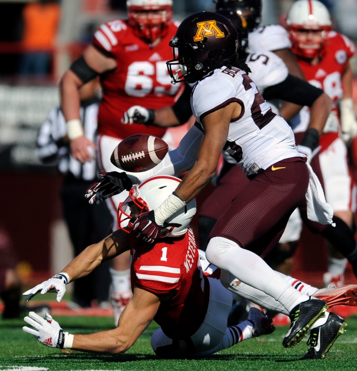 Nebraska Cornhuskers wide receiver Jordan Westerkamp (1) is unable to make the catch as he is tackled by Minnesota Golden Gophers defensive back Briean Boddy-Calhoun (29) during a game on Saturday, Nov. 22 in Lincoln, Neb. (© Matt Gade)