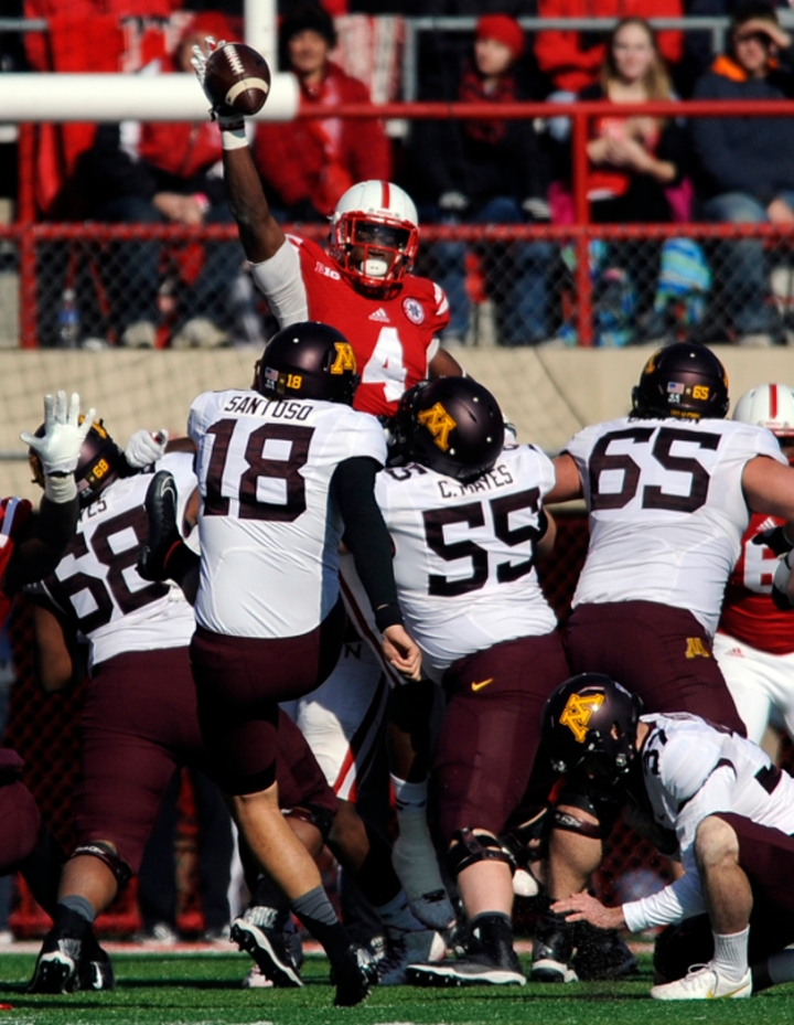 Nebraska Cornhuskers defensive end Randy Gregory (4) blocks a Minnesota Golden Gophers place kicker Ryan Santoso (18) field goal attempt during a game on Saturday at Memorial Stadium in Lincoln. (© Matt Gade)