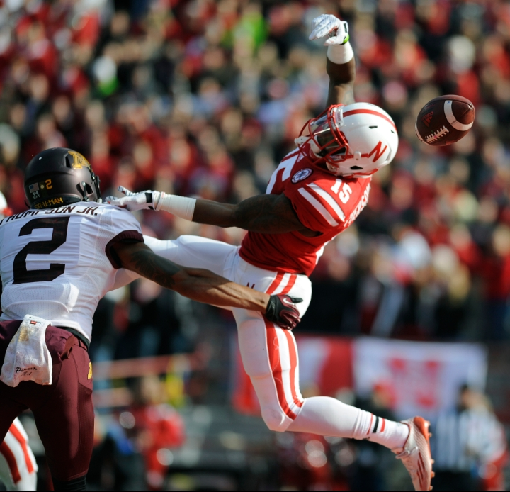 Nebraska Cornhuskers wide receiver De'Mornay Pierson-El (15) is unable to make a grab as Minnesota Golden Gophers defensive back Cedric Thompson (2) defends during a game on Saturday at Memorial Stadium in Lincoln. (© Matt Gade)