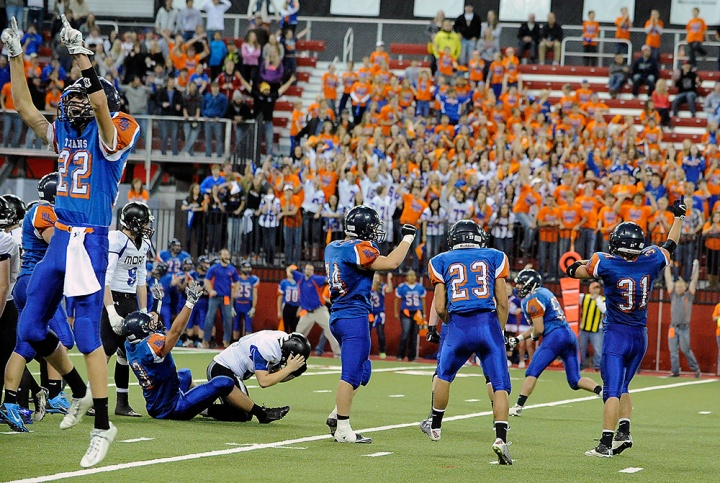 The Parkston Trojans celebrate a missed St. Thomas More Cavaliers field goal that would have tied the game instead gave the Trojans the win during the 11B state championship game on Friday at the DakotaDome in Vermillion. (Matt Gade/Republic)