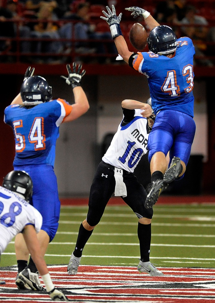 Parkston's Brady Reiff (43) gets air to block a pass by St. Thomas More's Matthew Eastmo (10) during the 11B state championship game on Friday at the DakotaDome in Vermillion. (Matt Gade/Republic)