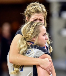 Mount Vernon/Plankinton's Makaela Karst, back, hugs Jorgan Erdahl following their match against Sioux Falls Christian in the Class A state volleyball championships on Saturday at the Denny Sanford Premier Center in Sioux Falls. (Matt Gade/Republic)