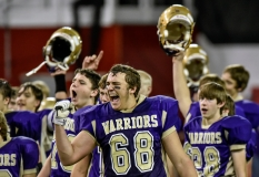 Winner's Wyatt Ewing (68) and the rest of the Warriors celebrate their win over Tri-Valley during the class 11B state championships at the DakotaDome on Friday in Vermillion. (Matt Gade/Republic)