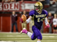 Winner's Windsor Barry (14) bobbles a reception during the class 11B state championships at the DakotaDome on Friday in Vermillion. (Matt Gade/Republic)