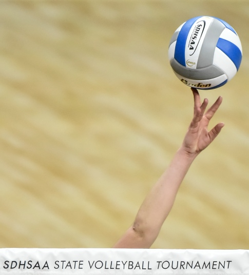 A Mount Vernon/Plankinton Titan tips the ball over the net during a match against Red Cloud in the first round of the Class A state volleyball tournament on Thursday at the Denny Sanford Premier Center in Sioux Falls. (Matt Gade/Republic)