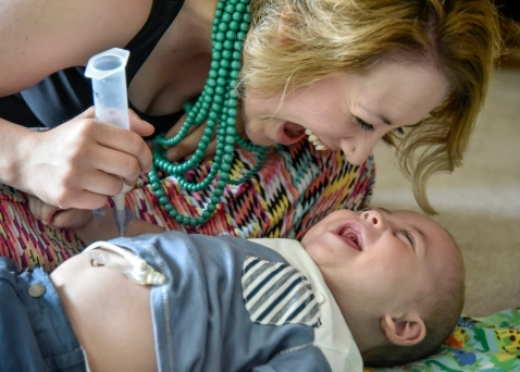 One-year-old MarcJon (MJ) Brakke laughs with his mom Sabreena while she feeds him with a tube in their home earlier this month. One of MJ's diagnoses requires him to be fed through his stomach rather than orally. (Matt Gade/Republic)