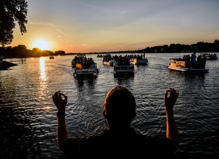 Ryan Stahle leads the Mitchell High School Marching Band as performs its annual Boat Parade on Friday Night on Lake Mitchell. (Matt Gade/Republic)