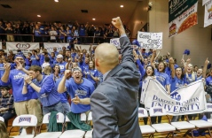 Dakota Wesleyan Head Coach Matt Wilber gives a fist pump to the crowd after their win against the College of Idaho on Saturday during the third round of the NAIA Division II National Championship Tournament in the Keeter Gymnasium on the campus of the College of the Ozarks in Point Lookout, Mo. (Matt Gade/Republic)