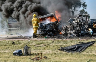 Emergency Responders work to put out a fire caused from a two-vehicle crash on westbound Interstate 90 approximately a mile east of Alexandria on Thursday afternoon. (Matt Gade/Republic)