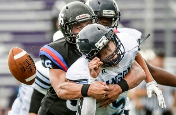 Woonsocket/Wessington Springs/Sanborn Central's Garrett Larson (56) sacks Hanson's Andrew Arend (5) causing a fumble in the second quarter of a game on Friday at the University of Sioux Falls Sports Complex in Sioux Falls. (Matt Gade/Republic)