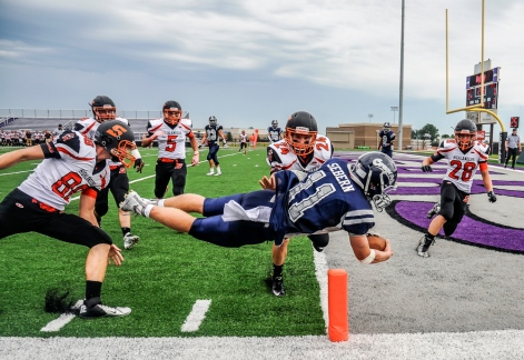 Burke/South Central's Zach Sebern (11) dives for a touchdown in front of the Scotland Highlanders defense during a game on Friday at the University of Sioux Falls Sports Complex in Sioux Falls. (Matt Gade/Republic)