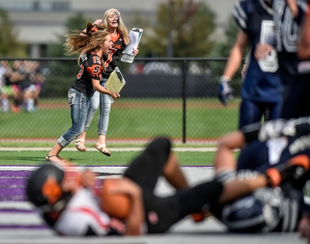 Scotland stat girls sophomore Elyssa Walloch, left, and Taylor Bietz, sophomore,cheer as Scotland's Tanner Iwan (7) scores the game winning touchdown during a game on Friday at the University of Sioux Falls Sports Complex in Sioux Falls. (Matt Gade/Republic)