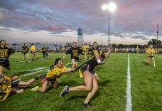 The seniors Tevyn Waddell drags junior Haylee Schoenfelder while carrying the ball during the annual powder puff football game at Joe Quintal Field on Thursday night in Mitchell as part of homecoming week. The seniors beat the juniors 28-0. (Matt Gade/Republic)