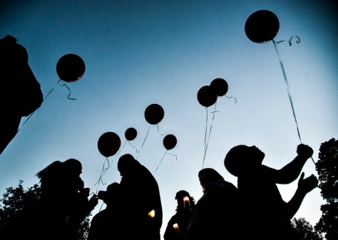 A group of family and friends prepare to launch balloons into the sky during a vigil held for Lenard Dean Boyer on Saturday evening at the band shelter at Hitchcock Park in Mitchell. Boyer (14) passed away on June 25, 2015 after suffering fatal injuries in a singe-vehicle accident. Karla Martinez, 23, of Mitchell, the driver of the vehicle who had a blood alcohol level of .148 pleaded guilty in Sept. to vehicular homicide and is scheduled for sentencing on Tuesday. (Matt Gade/Republic)