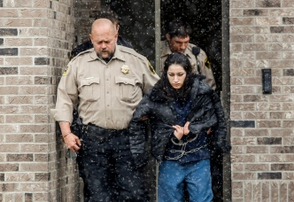 Maricela Diaz is escorted out of the Hanson County Courthouse by Hanson County Sheriff Randy Bartlett after being sentenced for 80 years on Friday afternoon in Alexandria. Diaz was found guilty in January for the murder and kidnapping of Jasmine Guevara that occurred in 2009.. (Matt Gade/Republic)
