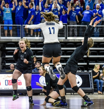 Sioux Falls Christian celebrates their match point over Mount Vernon/Plankinton to win the Class A state volleyball championships on Saturday at the Denny Sanford Premier Center in Sioux Falls. (Matt Gade/Republic)