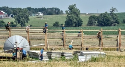A group of Amish men work on a building a structure on a farm along Highway 18 just northwest of Tripp on Thursday morning. (Matt Gade/Republic)