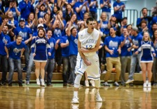 Dakota Wesleyan's Trae Vandeberg (13) celebrates a 3-point basket as the Corn Crib Crazies cheer from the bleachers during a game on Wednesday night at the Corn Palace in Mitchell. (Matt Gade/Republic)