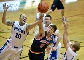 Dakota Wesleyan's Terrell Newton (10) and Midland University's Clayton Shepard (15) both fight for a rebound during a Great Plains Athletic Conference game on Sunday at the Corn Palace in Mitchell. (Matt Gade/Republic)