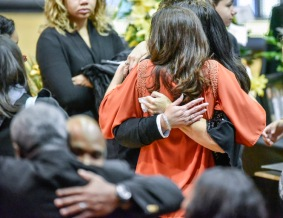 Family and friends of Gary Munsen console each other following a funeral for the former Mitchell High School teacher and basketball coach on Monday morning at the Corn Palace in Mitchell. (Matt Gade/Republic)