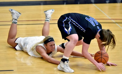 Morningside's Taylor Bahensky (5) tries grabbing a loose ball underneath Dakota Wesleyan's Amber Bray (44) during a game on Wednesday night for the Great Plains Athletic Conference tournament championship at the Rosen-Verdoorn Sports Center in Sioux City, Iowa. (Matt Gade/Republic)