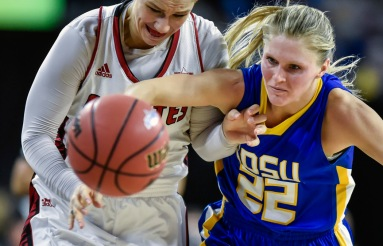 University of South Dakota's Nicole Seekamp (35) and South Dakota State University's Chloe Cornemann (22) scramble for a loose ball during a game in the Summit League conference championship on Tuesday at the Denny Sanford Premier Center in Sioux Falls. (Matt Gade/Republic)