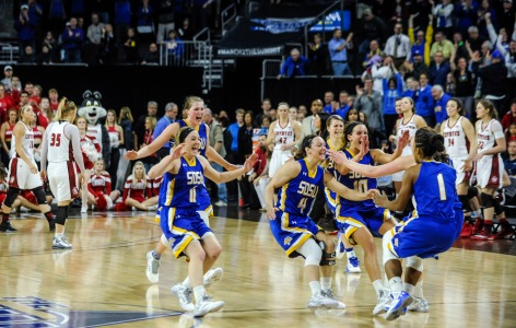 The South Dakota State University Jackrabbits celebrate their win over the University of South Dakota Coyotes in the Summit League conference championship on Tuesday at the Denny Sanford Premier Center in Sioux Falls. (Matt Gade/Republic)