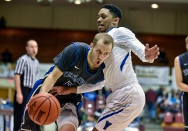 Dakota Wesleyan's Trae Bergh (5) drives past the defense of York College's Chris Smith (11) during the second round of the NAIA Division II men's national tournament on Friday night in the Keeter Gymnasium on the campus of the College of the Ozarks in Point Lookout, MO. (Matt Gade/Republic)