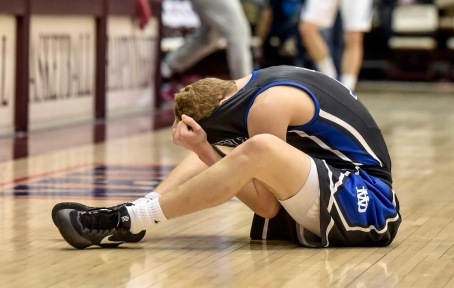 Dakota Wesleyan's Tate Martin (11) reacts to the Tigers loss to the York College Panthers during the second round of the NAIA Division II men's national tournament on Friday night in the Keeter Gymnasium at the College of the Ozarks in Point Lookout, MO. (Matt Gade/Republic)