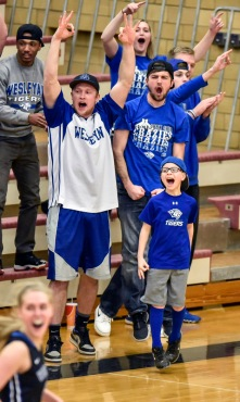 The Tiger student body celebrates a basket during a game against Morningside on Wednesday night for the Great Plains Athletic Conference tournament championship at the Rosen-Verdoorn Sports Center in Sioux City, Iowa. (Matt Gade/Republic)