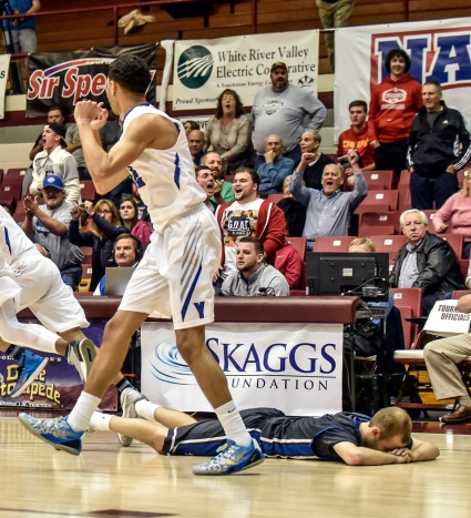 Dakota Wesleyan's Trae Bergh (5) lays on the ground after the Tigers loss to the York College Panthers during the second round of the NAIA Division II men's national tournament on Friday night in the Keeter Gymnasium at the College of the Ozarks in Point Lookout, MO. (Matt Gade/Republic)