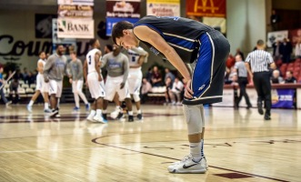 Dakota Wesleyan's Trae Vandeberg (13) reacts as the York College Panthers celebrate their win over the Tigers during the second round of the NAIA Division II men's national tournament on Friday night in the Keeter Gymnasium at the College of the Ozarks in Point Lookout, MO. (Matt Gade/Republic)