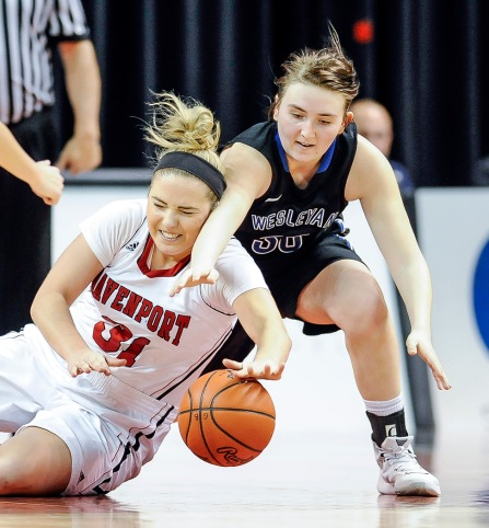 Davenport University's Emily Severn (31) and Dakota Wesleyan's Kelsey Bertram (30) scramble for a loose ball during the second round of the NAIA Division II women's national tournament on Friday morning at the Tyson Events Center in Sioux City, Iowa. (Matt Gade/Republic)